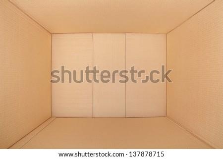 Empty cardboard box, inside view - stock photo