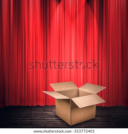 Empty cardboard box on a stage - stock photo