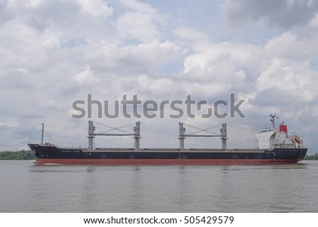 empty cargo ship sailing on the river