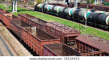 Empty cargo trains and fuel tankers - stock photo