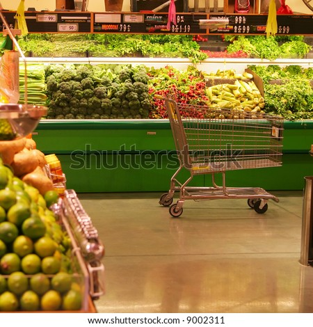 Empty Cart in the Produce Aisle - stock photo