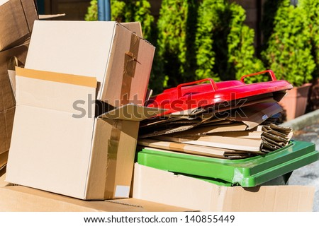 empty cartons of packages waiting for transport to the waste paper collection. waste reduction through recycling ok���¶logische - stock photo
