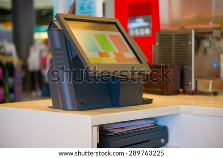 Empty cash desk terminal with computer touch screen in cafe - stock photo