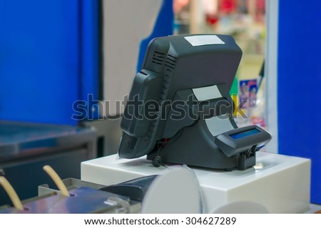 Empty cash desk with computer terminal in cafe