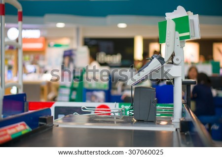 Empty cash desk with computer terminal in supermarket - stock photo