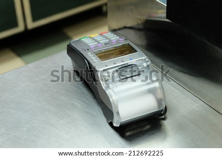 Empty cash desk with terminal in supermarket, a lot of copyspace - stock photo