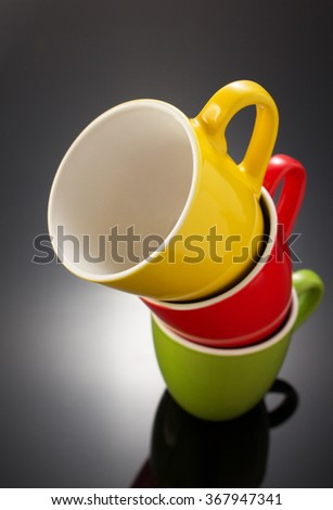 empty ceramic cup on black background