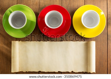 empty ceramic cup on wooden background - stock photo
