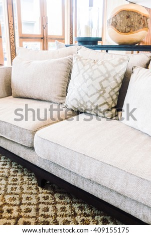Empty chair and pillow on sofa with table light lamp decoration interior of living room interior - Vintage Light Filter