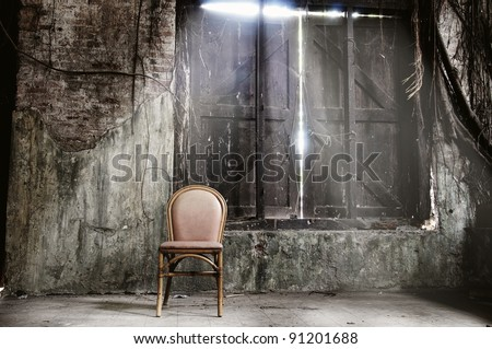 Empty chair and ray of light - stock photo