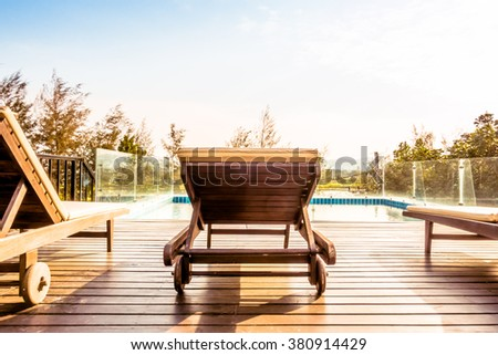 Empty chair and swimming pool at hotel resort - Vintage Filter