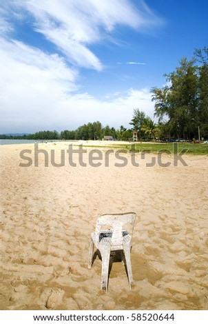 Empty Chair in an Empty Beach - stock photo