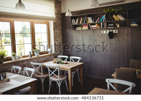 Empty chairs and tables in bakery shop