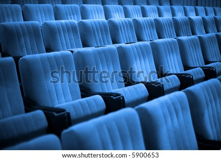 Empty chairs at cinema or theatre. Blue Tone - stock photo
