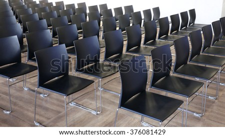 Empty chairs in a modern conference room. Shallow depth of field   - stock photo