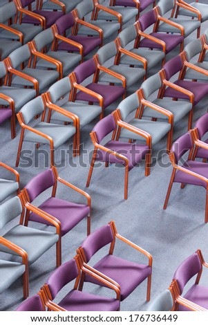 Empty chairs in an auditorium - stock photo