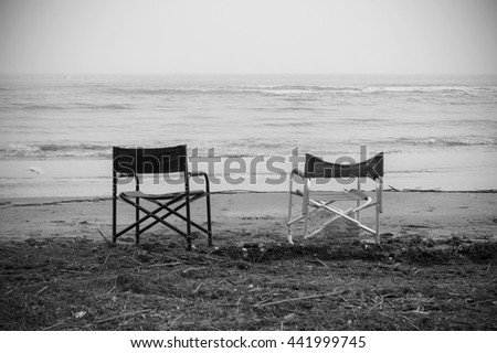 Empty chairs in front of sea  - stock photo