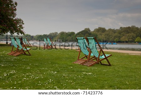 Empty chairs in Hyde park, London - stock photo