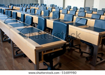 Empty chairs in meeting or conference room