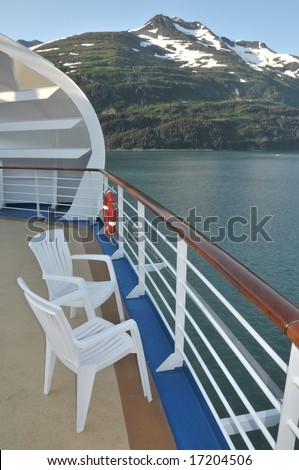 Empty chairs on a cruise ship in Alaska - stock photo