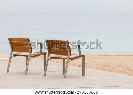 empty chairs on the beach - stock photo