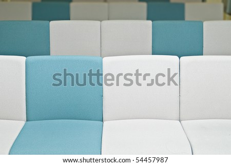 Empty chairs with white and blue color in office with nobody. - stock photo