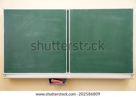 empty chalkboard in a classroom / Classroom - stock photo