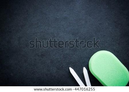 empty chalkboard with sponge chalk eraser. Text template board - stock photo