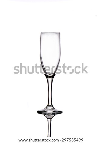 Empty champagne glass with reflection on white background - stock photo