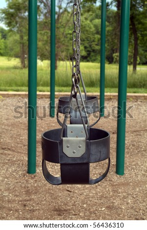 Empty childhood swing set