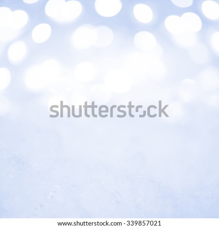 Empty Christmas Decoration with Snow and Background of Blurred Holiday Lights. Ready for Placing Your Object in Decoration - stock photo