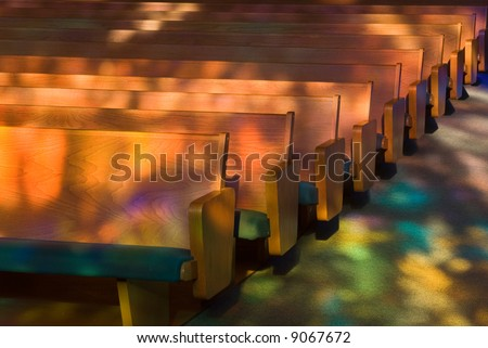 Empty church pews with Heavenly Light. - stock photo
