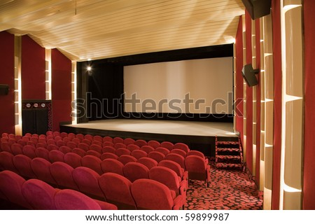 Empty cinema auditorium with line of chairs and projection screen. Ready for adding your own picture. Side view. - stock photo
