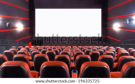 Empty cinema auditorium with screen and seats - stock photo