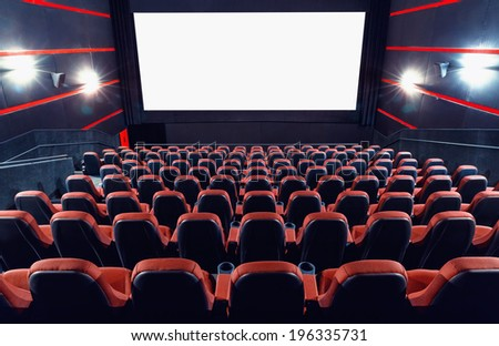 Empty cinema auditorium with screen and seats
