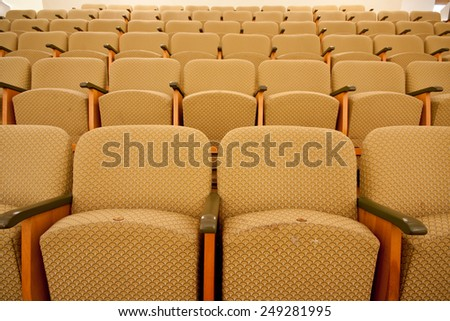 empty cinema chairs in row - stock photo