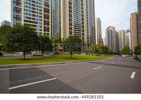 Empty City road surface floor with streetscape buildings  - stock photo