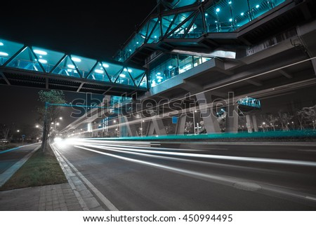 Empty City road surface floor with viaduct bridge of night scene