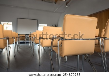 Empty classrom with lot of chairs closeup - stock photo