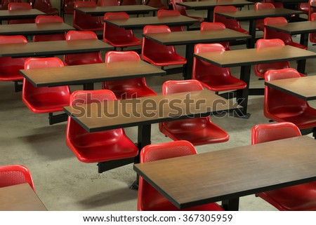 Empty classroom fill with red lecture seats - stock photo