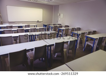 Empty classroom in the college with desks and chairs