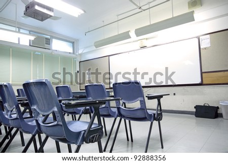 empty classroom with chair and board - stock photo