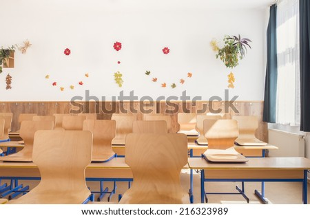 Empty classroom with chairs and desks,decorated. - stock photo