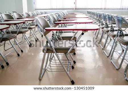 empty classroom with many armchairs - stock photo