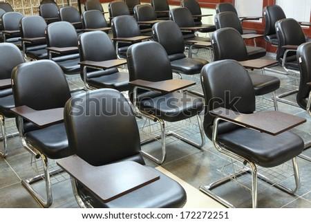 empty classroom with many armchairs . - stock photo