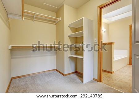 Empty closet with carpet and shelves. - stock photo