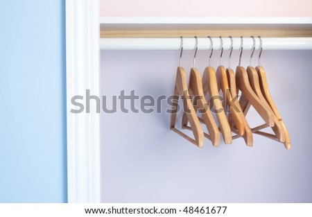 Empty Coat Hangers In An Closet No Clothes