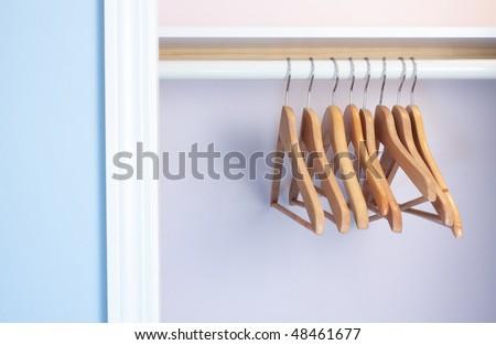 Empty coat-hangers in an empty closet  no clothes - stock photo