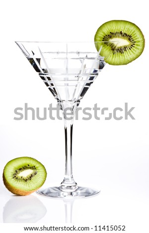 Empty cocktail glass decorated with a slice of kiwi - stock photo