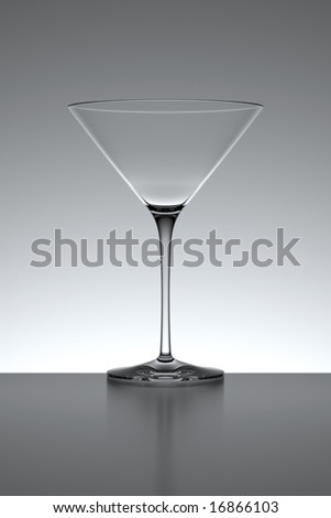 Empty cocktail glass isolated over a gray backlit background.